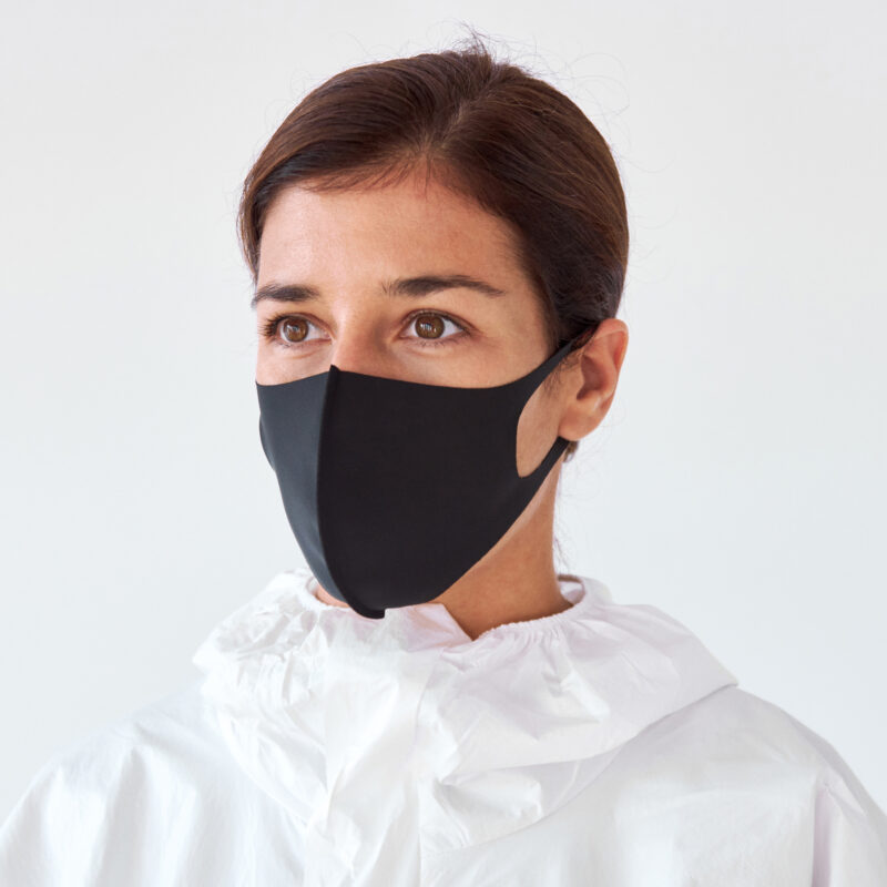 Woman wearing a black cotton face mask